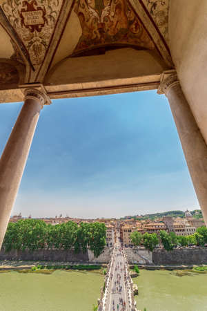 ROME, ITALY - MAY 31, 2017: Aerial view of the old town of Rome with the Ponte Sant Angelo, from San Angelo castle and unidentified people. Old town of Rome is listed under the UNESCO world heritage.