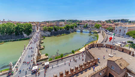 tiber: ROME, ITALY - MAY 31, 2017: Aerial view of the old town of Rome with the Ponte Sant Angelo, from San Angelo castle and unidentified people. Old town of Rome is listed under the UNESCO world heritage.