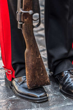 infantry: Detail of a protocol uniform of an Italian soldier. Black, red and rifle.