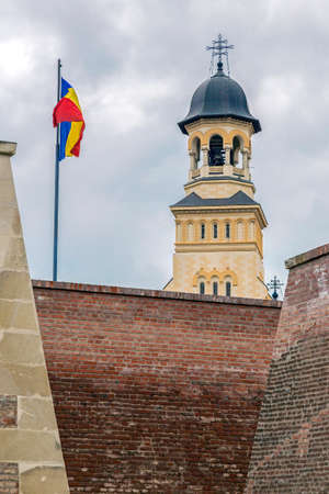 View with Bell tower from Coronation Cathedral in Alba Iulia city, Transylvania, Romania and fortress wall from Carolina citadel.