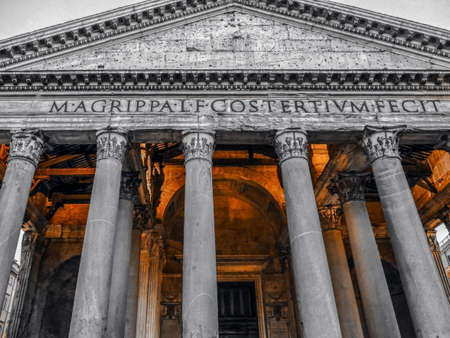 Black and color front view of Rome Pantheon at dusk. Unesco world heritage site.