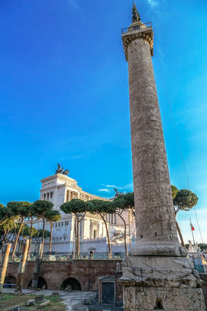 Ruins of Trajan forum with Trajan column and Vittorio Emmanuele II monument in background. Rome, Italy.