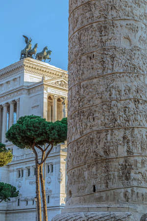 Trajan column and Vittorio Emmanuele II monument in background. Rome, Italy. Stock Photo