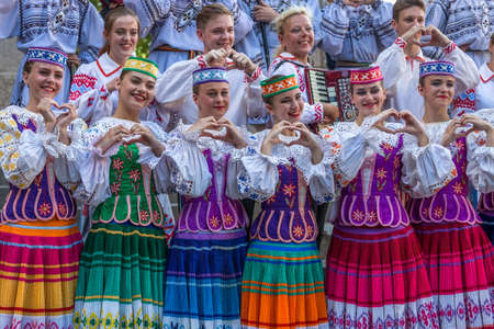 TIMISOARA, ROMANIA - JULY 6, 2017: Young dancers from Belarus in traditional costume present at the international folk festival International Festival of hearts organized by the City Hall Timisoara.