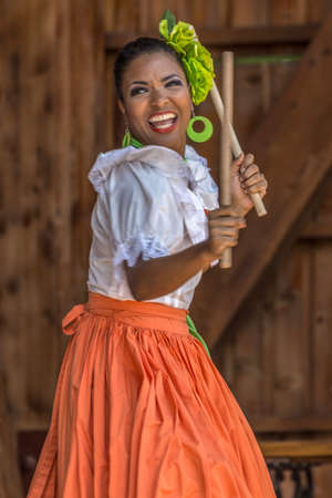 TIMISOARA, ROMANIA - JULY 9, 2017: Young dancer girl from Puerto Rico in traditional costume perform at the international folk festival Фото со стока - 82390450
