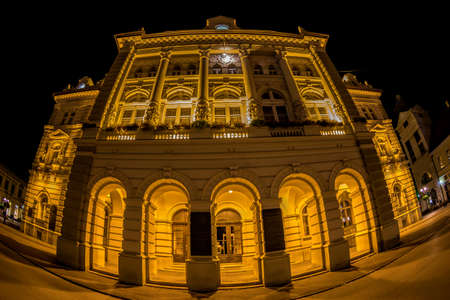 NOVI SAD, SERBIA - JULY 30, 2017: Night view of the Liberty Square (Trg. Slobode) with City Hall, Mary Church and old buildings. One of the cities designated as the European capital of culture in 2021.
