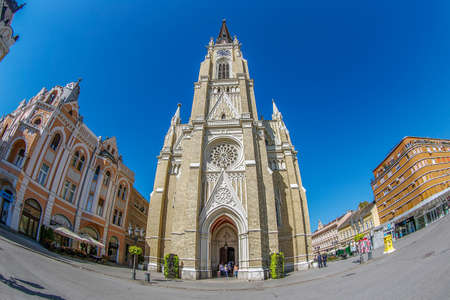 NOVI SAD, SERBIA - JULY 30, 2017: View of the Liberty Square (Trg. Slobode) with Mary Church and old buildings. One of the cities designated as the European capital of culture in 2021.
