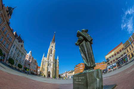 designated: NOVI SAD, SERBIA - JULY 30, 2017: View of the Liberty Square (Trg. Slobode) with Mary Church, monument and old buildings. One of the cities designated as the European capital of culture in 2021.
