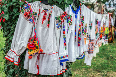 Old traditional Romanian folk costumes with embroidery specific for Bistrita-Nasaud area Romania, exposed for sale at one traditional fair.
