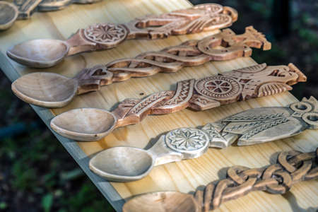 Decorative wooden spoons carved with traditional Romanian patterns. Stock Photo