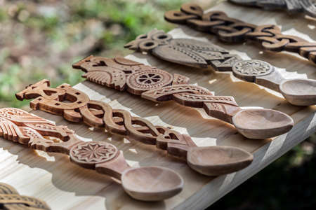 Decorative wooden spoons carved with traditional Romanian patterns. Stock fotó