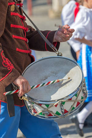 Closeup detail of retro hungarian soldier drummer, participant during one parade in outdoors. Stock Photo