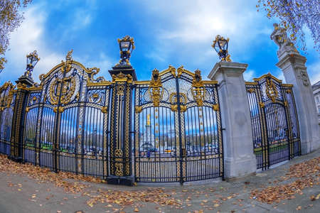 LONDON, ENGLAND - NOVEMBER 29, 2017: Gates with golden details surrounding the entrance of Green Park next to Buckingham Palace. Editorial