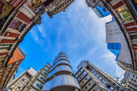 LONDON, ENGLAND - NOVEMBER 27, 2017: New and old together. Wide angle shot with new Lloyds Building (also known as The Inside-Out Building) and old buildings from Leadenhall market. Editorial
