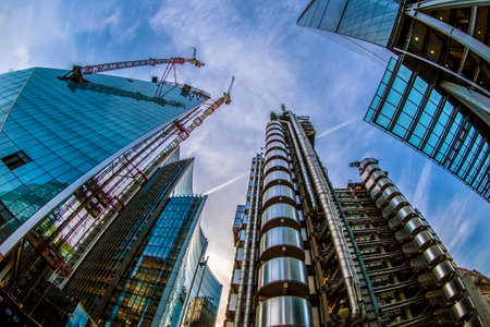 LONDON, ENGLAND - NOVEMBER 27, 2017: Wide angle shot of skyscrapers in Central London, including the Lloyds Building (also known as The Inside-Out Building) and building in construction.