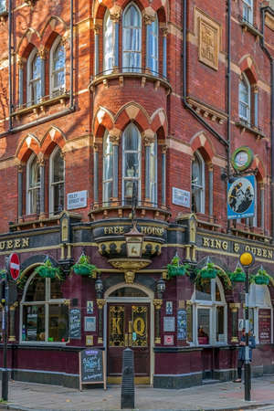 LONDON, ENGLAND - NOVEMBER 28, 2017: Historical building in Victorian architecture with typical facade and english pub.