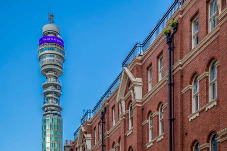 LONDON, UK - NOVEMBER 28, 2017: Old and new together. Victorian architecture at old buildings and BT Tower-Post Office Tower with 189 metres high, designed by architects Eric Bedford and G. R. Yeates. Editorial