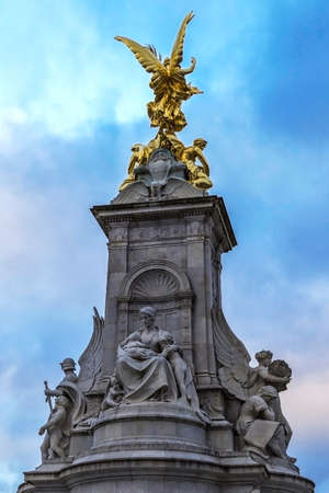 LONDON, UK - NOVEMBER 29, 2017: Detail of Nike,Goddess of Victory.Statue on the Victoria Monument Memorial outside Buckingham Palace.The monument was unveiled in 1911 with fountain and bronze figures. Editorial