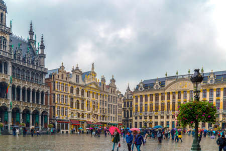 BRUSSELS, BELGIUM - OCTOBER 15, 2015: Grand Place-Grote Markt with the House of Dukes of Brabant, one part of King House and Guild Houses in one rainy day. Part of the UNESCO World Heritage.