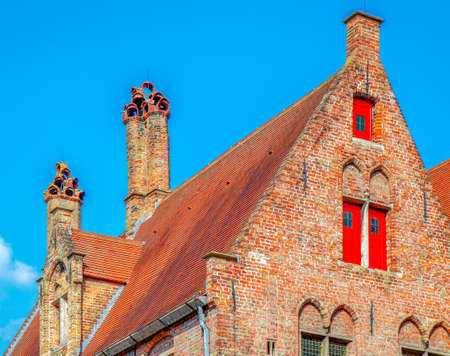 Typical house and roof at one historic building in Bruges, Belgium.