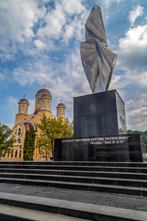 RESITA, ROMANIA - SEPTEMBER 1, 2016: New monument with the inscription ,,It is sweet and honorable to die for the fatherlandand