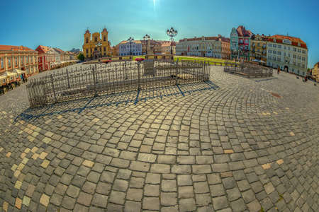 TIMISOARA, ROMANIA - AUGUST 24, 2017: View of one part at Union Square in Timisoara, Romania, with old buildings. Trinity Statue, german Dom and art museum in background at sunset time. Editorial