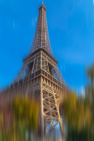 Background with Eiffel tower from Paris in motion blur.