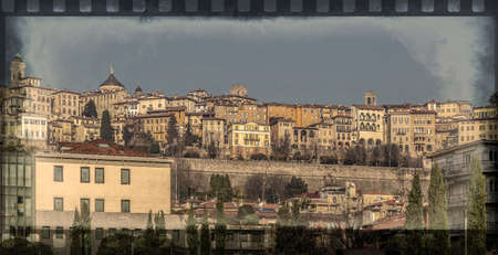 Old photo with panorama at one part of upper city Citta Alta in Bergamo, Italy. Border filter applied and vintage processing. Stock fotó