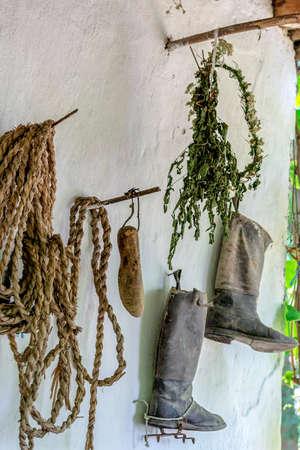 Objects exposed on a exterior wall of one farmhouse of Slovak ethnics.The Banat region (part of Transylvania), Romania.