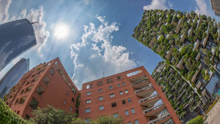 MILAN, ITALY-JUNE 22, 2018:Bosco Verticale, residential ecological buildings where grow more than 1.000 specimens of plants, together wits usual apartments and Unicredit Bank Tower in Porto Nuova.