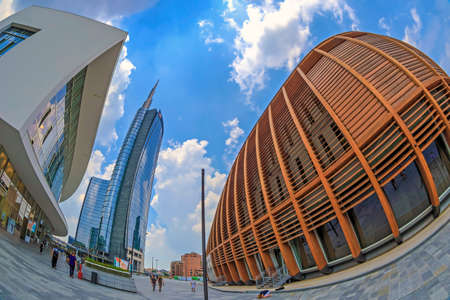 MILAN,ITALY-JULY 22,2018:Unicredit Pavilion designed by Michele De Lucchi. Unicredit Bank Tower the tallest skyscraper in Italy by Cesar Pelli.Gae Aulenti square, financial district at Porta Garibaldi
