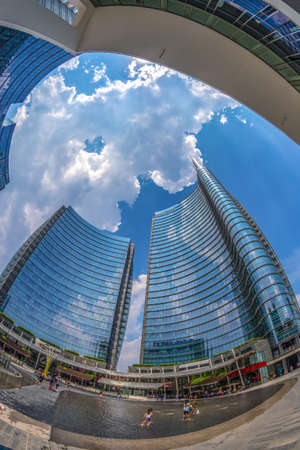 MILAN,ITALY-JULY 22,2018:Wide angle view of the skyscrapers in Gae Aulenti square the new financial district at Porta Garibaldi,with Unicredit Bank Tower the tallest skyscraper in Italy by Cesar Pelli