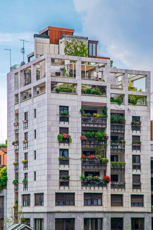 Residential ecological building in Milan, Italy, with lots of plants. Vertical Forest or Vertical Gardens apartments is located in Porta Nuova district. Stock Photo