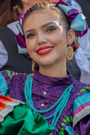 ROMANIA, TIMISOARA - JULY 5, 2018: Young woman from Mexico in traditional costume, present at the international folk festival, Publikacyjne