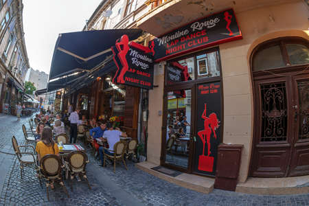 BUCHAREST, ROMANIA - JULY 17, 2018: Small and picturesque street terraces with tourists, located in the historical center of the city. 에디토리얼