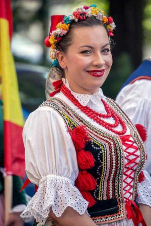 TIMISOARA, ROMANIA - JULY 6, 2017: Polish women dancer in traditional costume present at the international folk festival