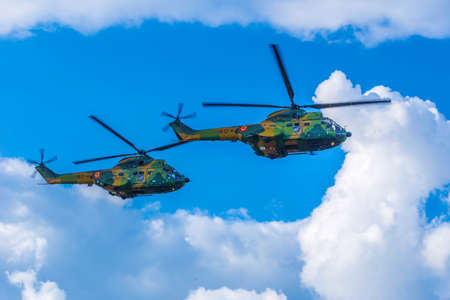 TIMISOARA, ROMANIA - JUNE 23, 2018: Helicopters doing demonstrations at one air show organized by international airport from Timisoara.