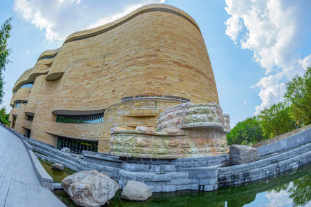 WASHINGTON DC, USA-SEPTEMBER 4, 2018: Detail of facade at National Museum of The American Indian dedicated to the life,languages,literature,history and arts of the Native Americans.Wide angle view.