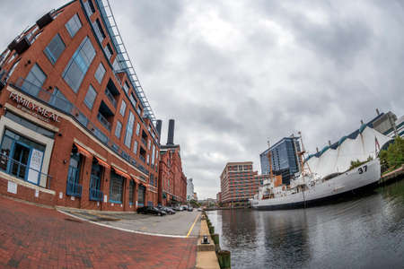 BALTIMORE, MARYLAND, USA - SEPTEMBER 8, 2018: Buildings and the USCGC Taney in the Inner Harbor. The Coast Guard Cutter Taney was the last ship floating after the Pearl Harbor Attack.