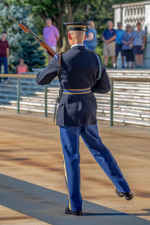 ARLINGTON, WASHINGTON, USA - SEPTEMBER 6, 2018 : Changing of the guard at the Tomb of the Unknown Soldier at Arlington National Cemetery. Morning light.