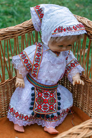 Doll dressed in traditional Romanian folk costume and exposed for sale at one traditional fair.