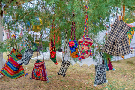 Background with bags embroidered and decorated with specific patterns of the Bistrita-Nasaud area, Romania, exposed for sale on a tree.
