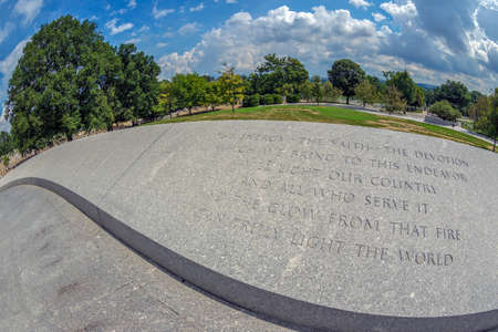 Arlington, Washington, USA - August 31, 2018: Engraved inscriptions on the assembly in front of the tomb of President J.F.Kennedy in the Arlington National Cemetery. Editorial