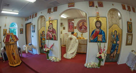 POTOMAC, MARYLAND, USA - SEPTEMBER 9, 2018: Priest praying in the altar of the Romanian Orthodox Church. 報道画像