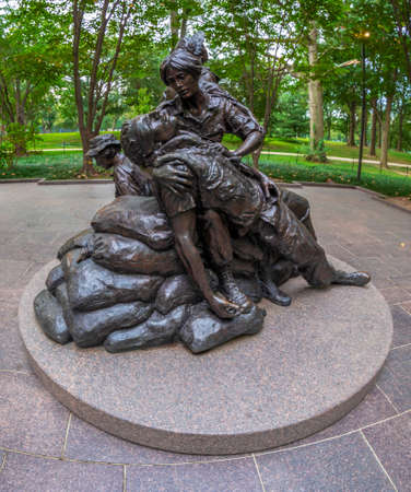 Washington DC, USA - August 31, 2018: Statue of Legacy of healing and hope in Vietnam Womens Memorial, by Glenna Goodacre, was made for honor the military service of women nurses in Vietnam war. Editorial