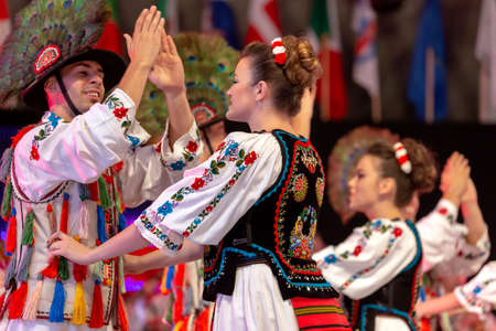 ROMANIA, TIMISOARA - JULY 7, 2018: Dancers from Romania in traditional costume, present at the international folk festival,