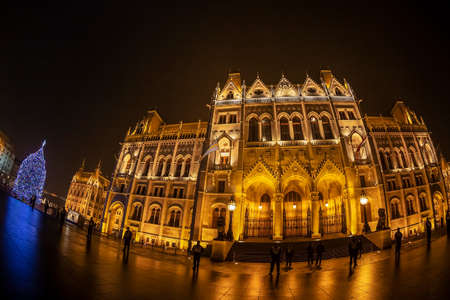 Budapest, Hungary - December 18, 2018: Night view of Hungarian Parliament Building, at Christmas time. House of the Country or House of the Nation,the seat of the National Assembly of Hungary.