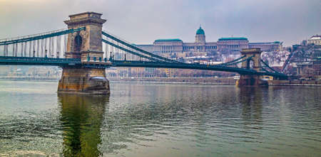 Chain Bridge in Budapest, Hungary. Suspended bridge over Danube river, from the nineteenth century, designed by William Tierney Clark. Buda shore and Castle in background. Фото со стока