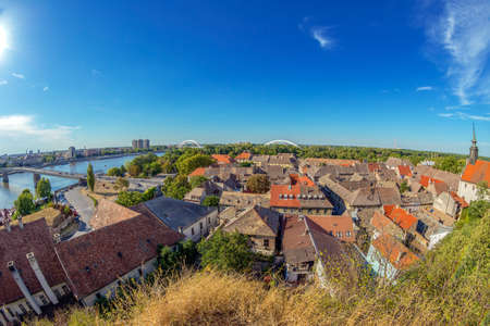Panoramic cityscape in Novi Sad, Serbia. Old and new, seen from the Petrovaradin fortress height.