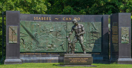 ARLINGTON, VIRGINIA, USA-AUGUST 31, 2018: The National Seabee Memorial, a sculpture and Seabee memorial by Felix de Weldon, installed along George Washington Memorial Parkway.